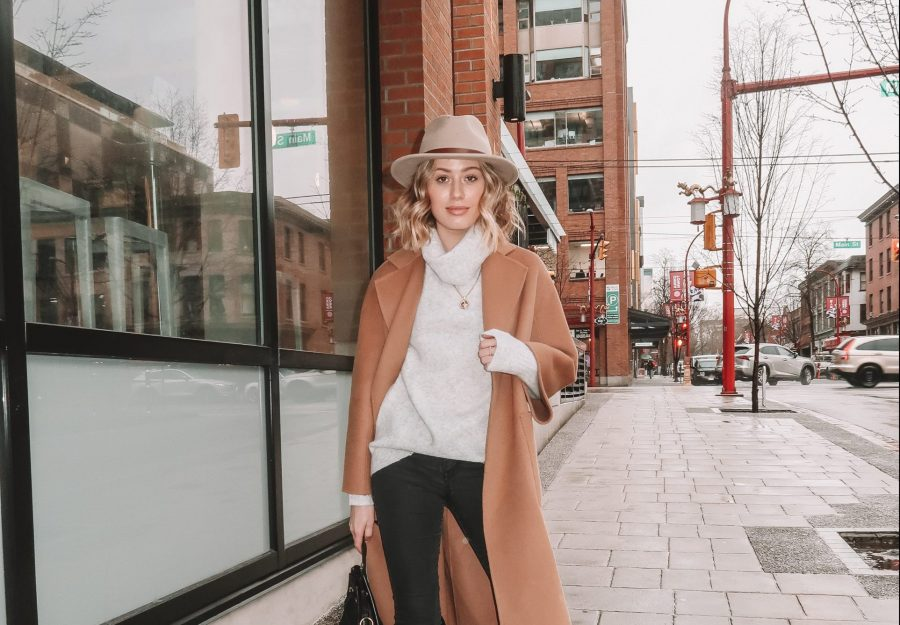 Karissa Pukas wearing a Camel Coat and star print boots