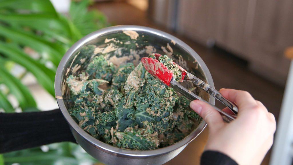 Mix sauce on kale