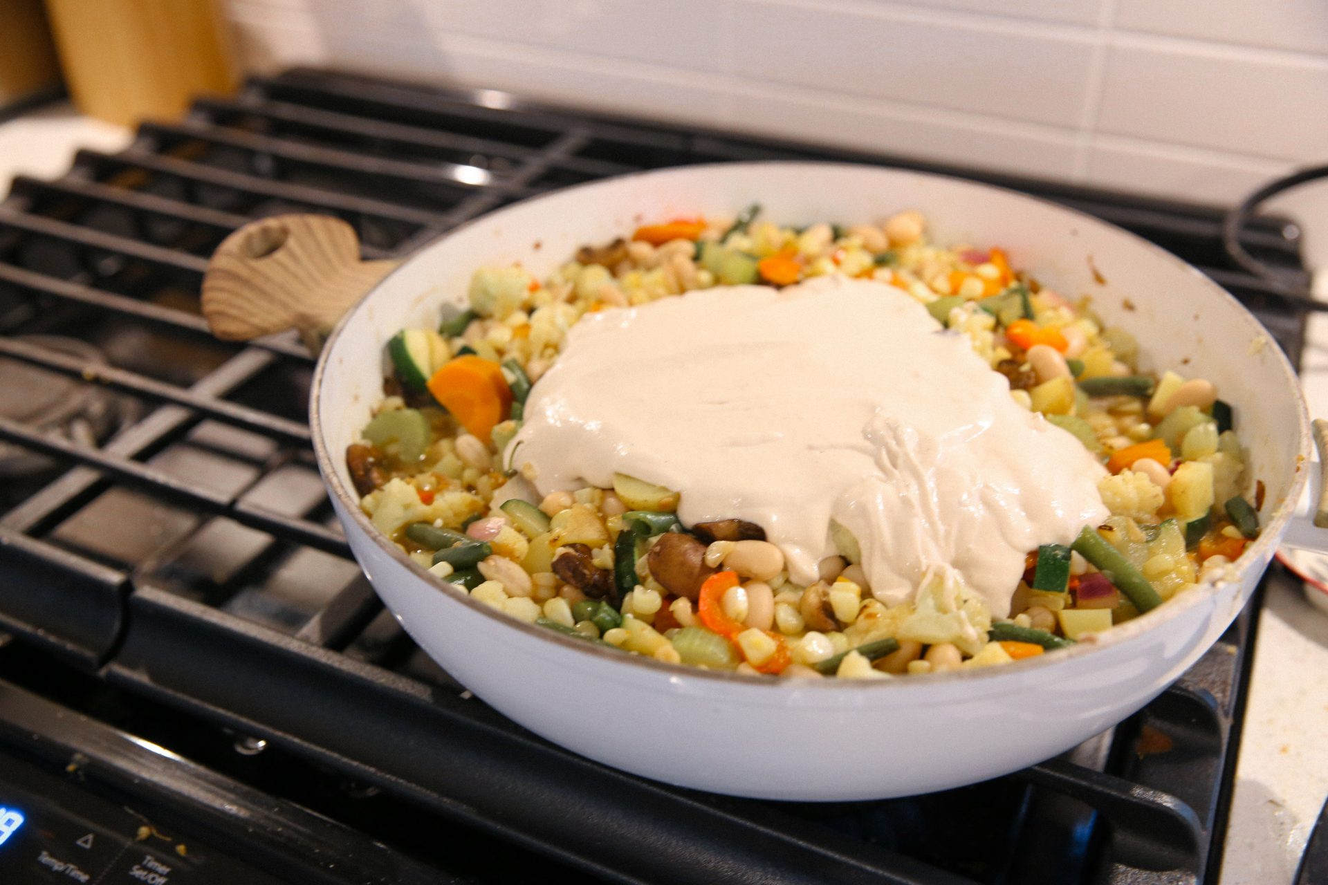 Sauteed vegetables with cashew cream on top