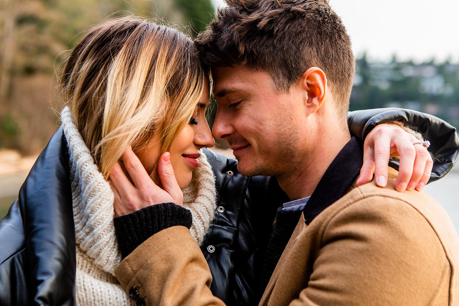 Glen holding Karissa's face in a close up romantic shot
