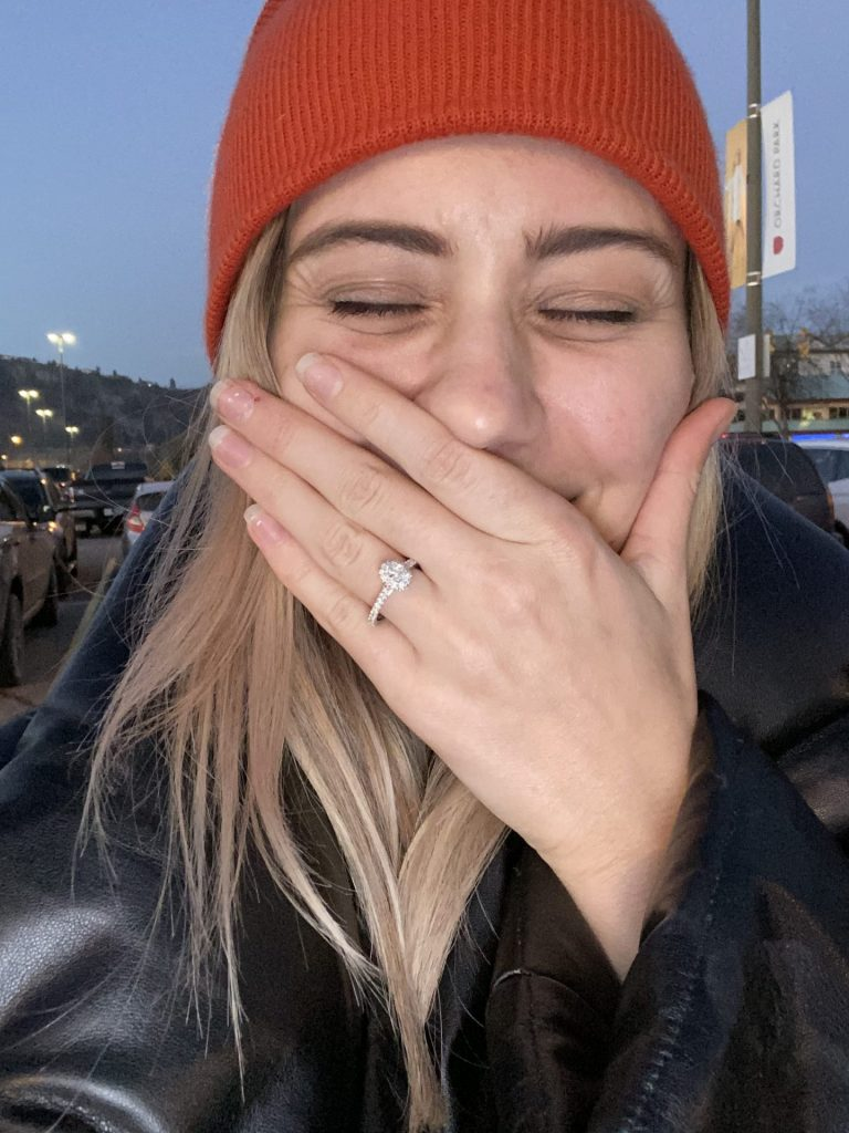 Karissa covering her mouth with her ring hand. She's clearly cried her makeup off
