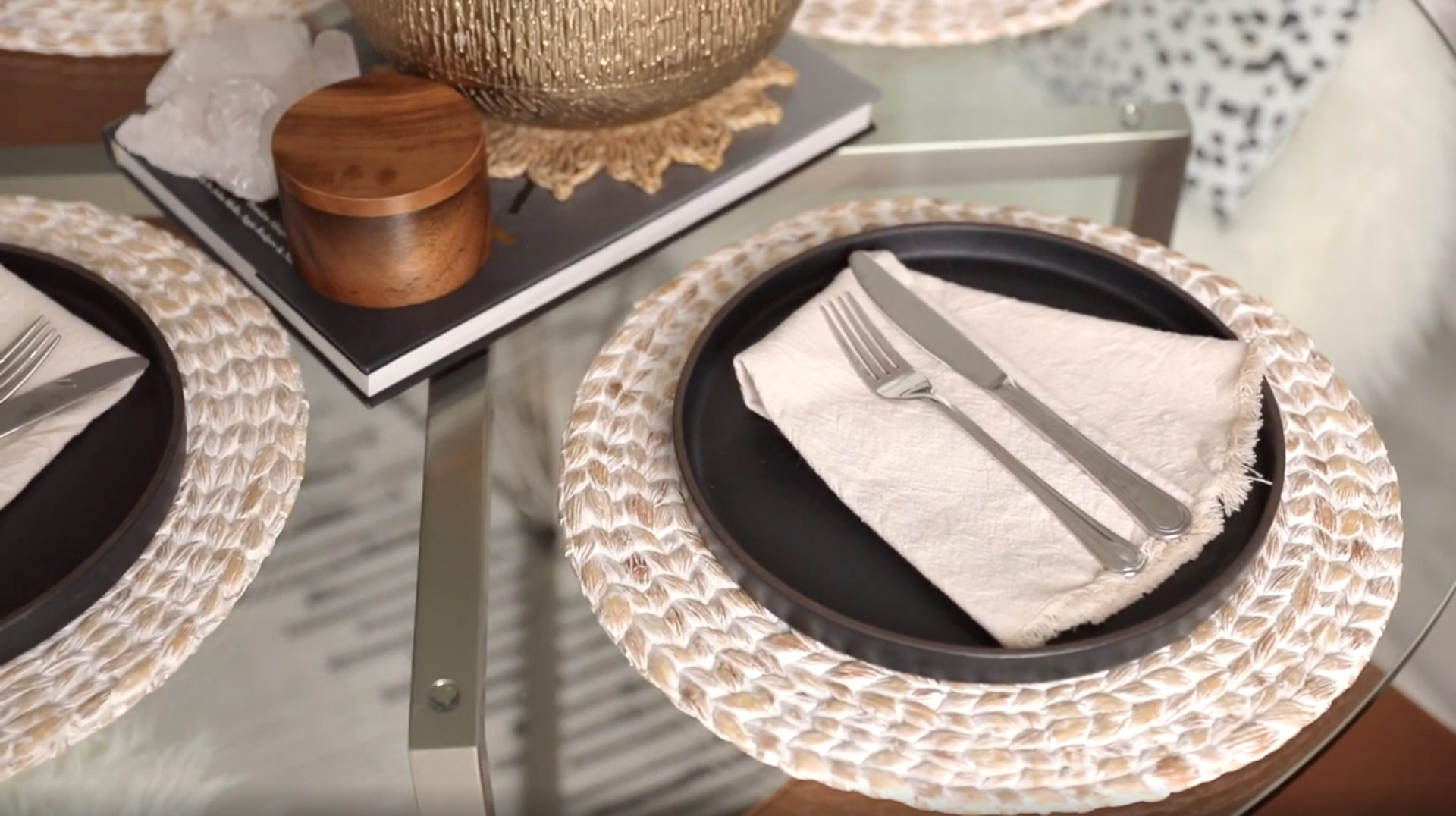 Close up shot of table top setting. Black Pitch Plates from Cb2, Linen Napkins